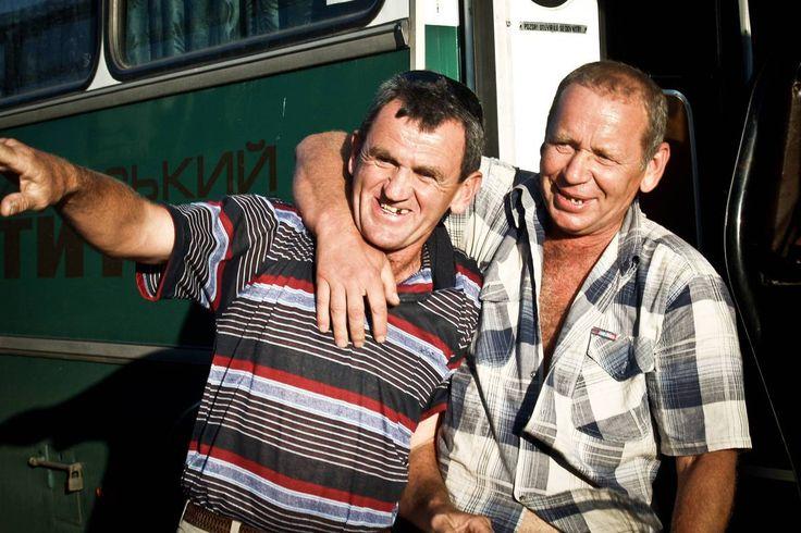 Two bus drivers share a moment after a shift in the Autonomous Republic of Crimea.  http://earth66.com/human/bus-drivers-share-moment-shift-autonomous-republic-crimea/
