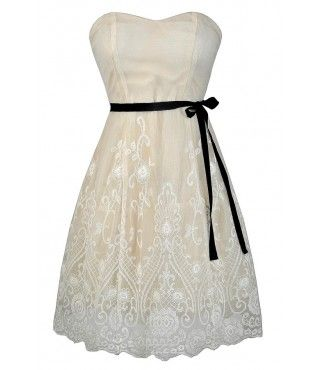 Bride to be ivory and black embroidered designer dress.