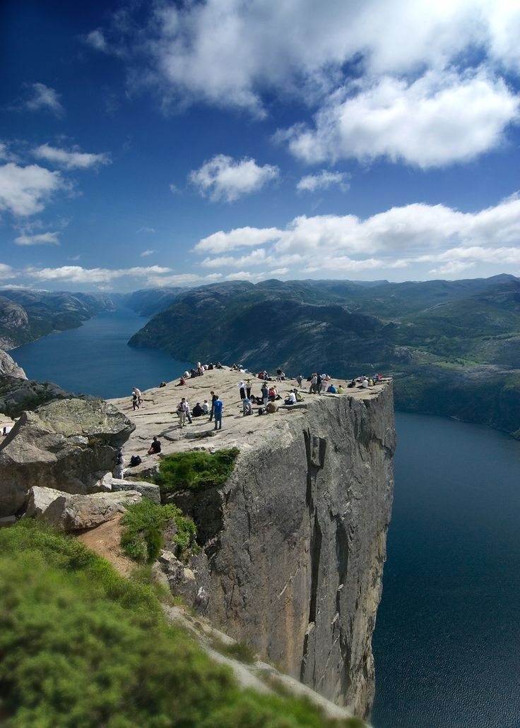 Preikestolen Pulpit Rock  is a massive cliff in Norway that towers 604 meters (1982 feet) in near vertical drop over the ocean