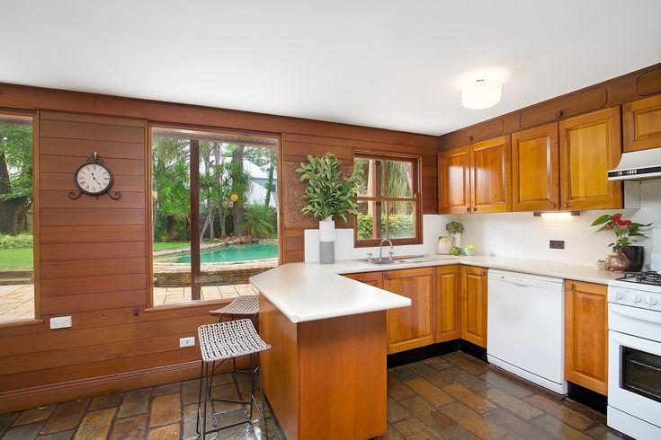 Timber kitchen, breakfast bench, overlooks pool, gardens, Pilcher Residential