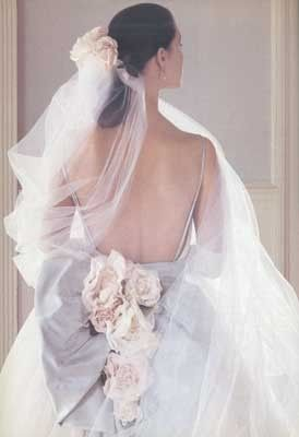 Pretty detail at the back can add feminine and unexpected loveliness to any dress, like this Christian Dior wedding gown!