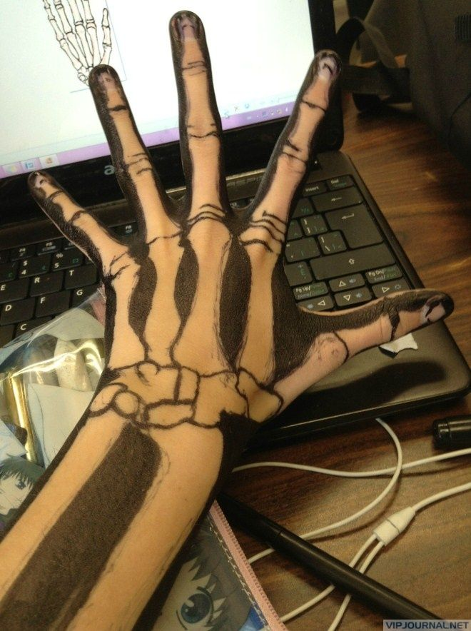 Skeleton drawing on hand...hope that's not permanent marker