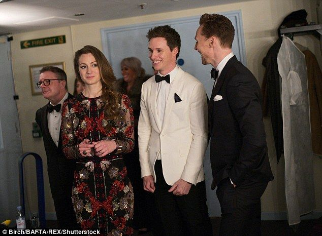 Waiting in the wings: Eddie gave a nervous grin with his wife and Tom Hiddleton backstage