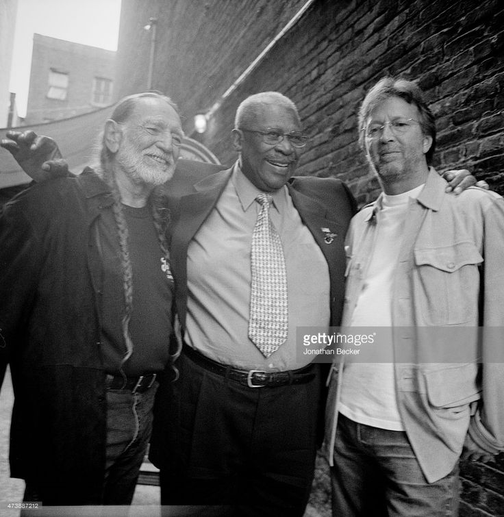 Musicians Willie Nelson, B.B. King and Eric Clapton are photographed for Vanity Fair Magazine on June 2, 2003 in the back alley of the Apollo Theater in Harlem, New York.