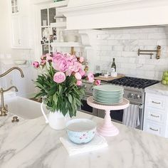 White marble kitchen countertop. Kitchen with white marble countertop #Whitemarblecountertopkitchen Pink Peonies. Rachel Parcell Pink Peonies Kitchen