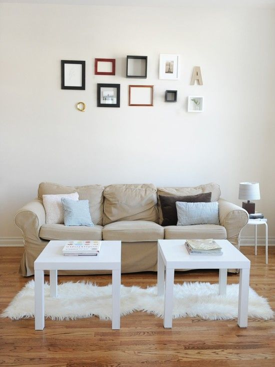 what not to do - size of objects & overall grouping much too small for the wall. And waaaay too high.