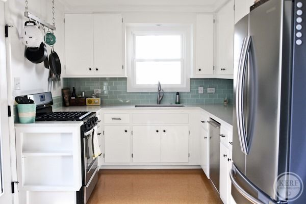 This.  I want this.  (White cabinets, blue glass subway tile backsplash, stainless appliances, gray countertops--quartz?,stainless sink, faucet)