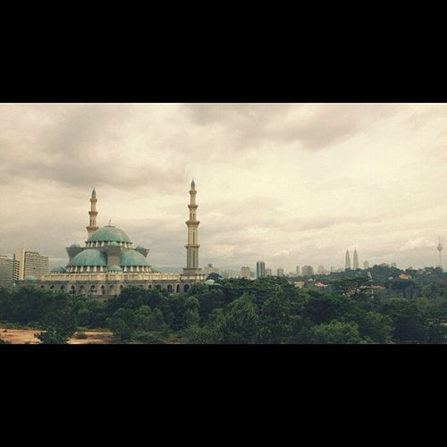 KL skyline with the call of the mosque