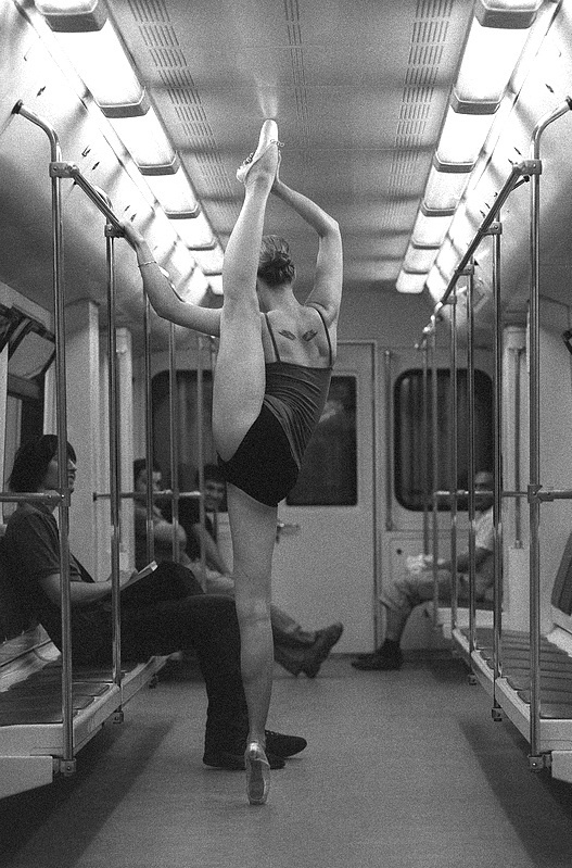 NYC.  Some say she is a nice MTA worker checking height for subway wagons...//Photo by Kiramed