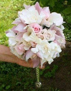 Gardenias, pink roses and lilies. I need to find out what that bouquet holder is!