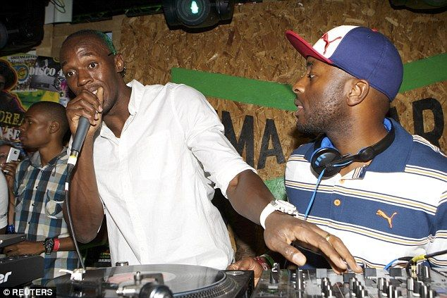 Party lover: Usain Bolt and DJ Manny Norte (right) attend to the decks in Brick Lane, east London in early August 2012. He has been branded a 'horrid' neighbour by model Jodi 'Jinx' Stewart-Henriques