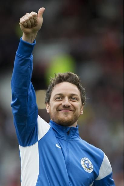 James mcAvoy giving a thumbs up signal just before kick-off at the soccer Aid match 2014.