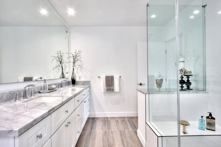 Italian Carrera Marble and soft gray Porcelain vain cut floors tie this restroom remodel all together. | Yelp