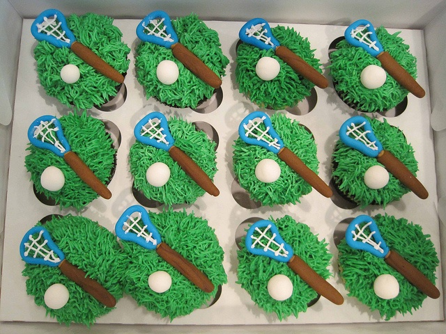 """Lacrosse cupcakes by sgodlove, via Flickr -  Topped with """"grass"""" buttercream and fondant lacrosse stick/ball."""
