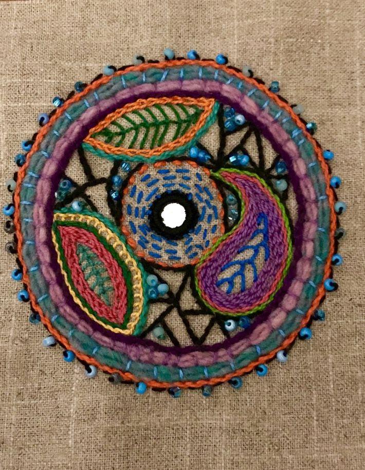 Small embroidered Mandala with Shisha mirror and beads. Stitchery by Claudia Moodyjones