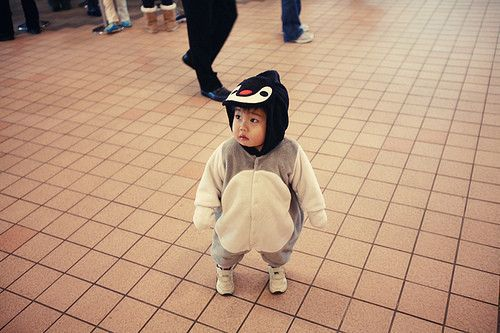 the cutest baby in a penguin costume ever.