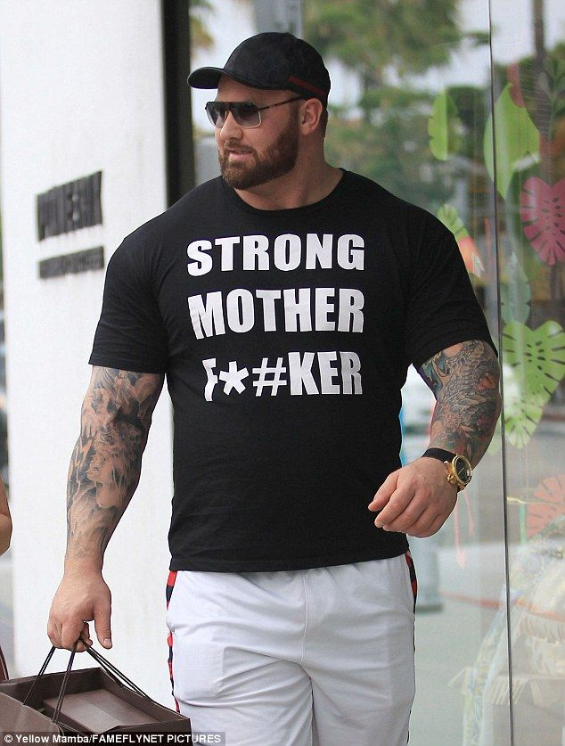 Tattooed sleeves: Hafþór - rocking a clingy 'Strong Mother F***er' T-shirt - reportedly weighs 395lbs and eats between six and eight meals a day to maintain his massive muscles