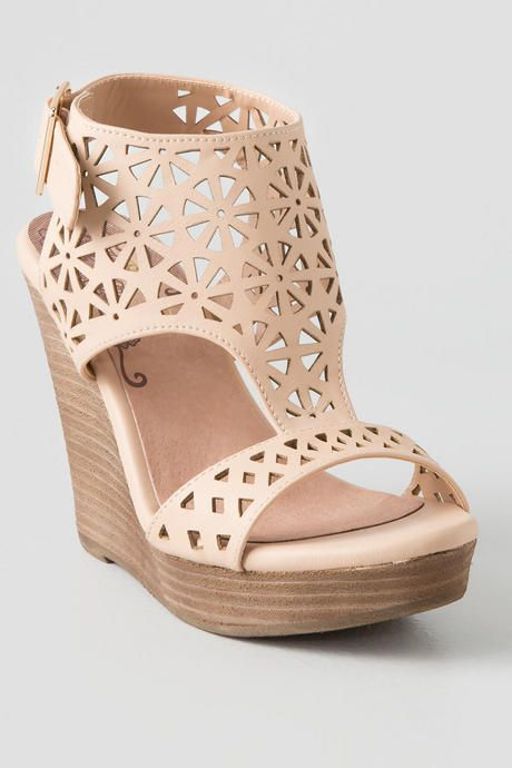 Make your legs look longer in the Miss Lasercut Wedge! Gorgeous laser cut nude wedges, perfect for spring and summer!