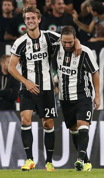 Juventus' Italian defender Daniele Rugani (L) celebrates with teammate Juventus'…