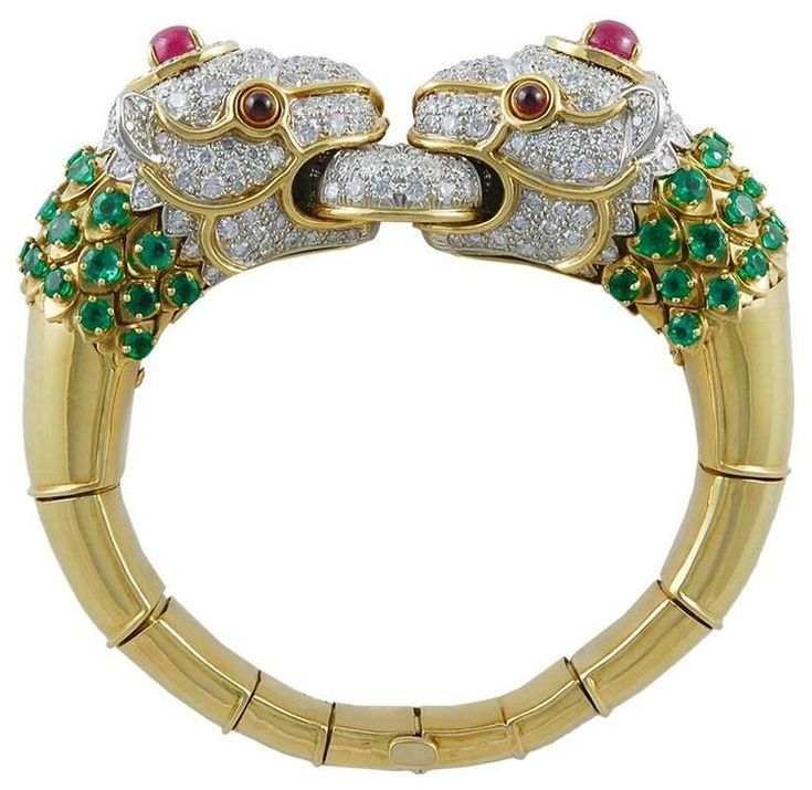 David Webb Diamond Emerald Ruby Lion Bracelet | From a unique collection of vintage bangles at https://www.1stdibs.com/jewelry/bracelets/bangles/