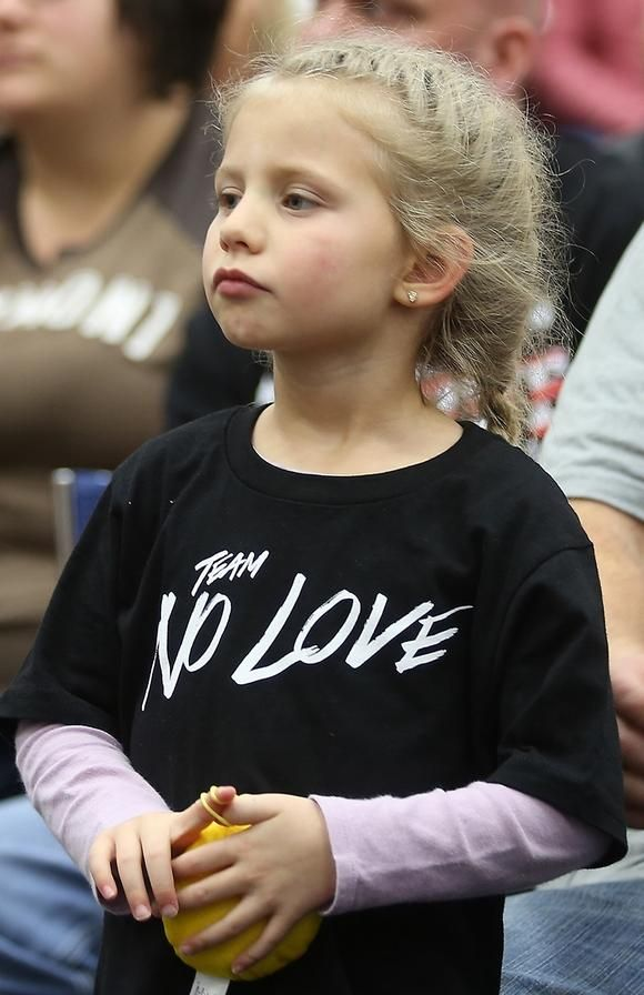 """A young Cody """"No Love"""" Garbrandt fan shows her support during an event to recognize the UFC bantamweight champ at Claymont High in Uhrichsville Sunday. www.timesreporter.com"""
