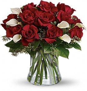This bouquet is called Be Still My Heart, but her heart wont be still when she sees this wildly romantic bouquet of a dozen red roses and white calla.