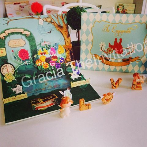 Alice in Wonderland story telling wedding Invitation concept with Pop Up 3D. Congratulation for Tika & Gerry for their engagement party #happyeverafter #wedding #engagement #party #3D #popup #hardcover #invitation #aliceinwonderland #unique #undangan  http://www.theinvitation.co.id