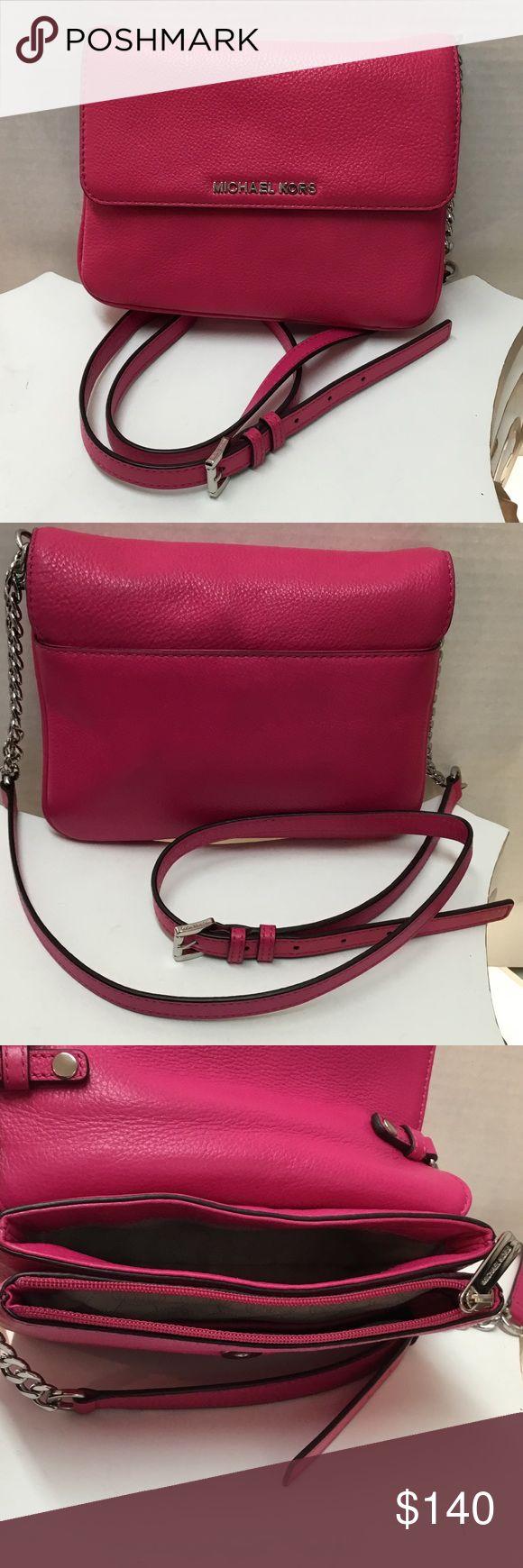Authentic Michael Kors Crossbody Handbag Store Display in excellent condition cross-body handbag. Hot pink in color. Michael Kors Bags Crossbody Bags