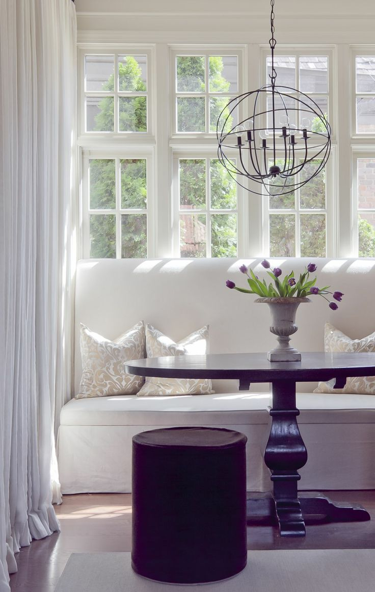 simple mix of rustic orb and table with white banquette