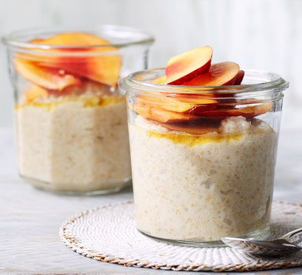 A healthy breakfast ofoats and quinoa withfresh ripe peach. Almond milk makes its suitable for dairy-free and vegan diets
