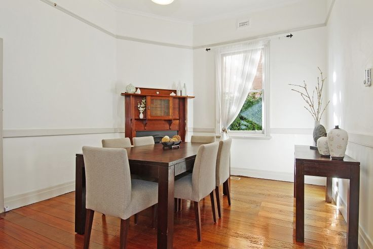 Classic dining table and fireplace meets modern dining.