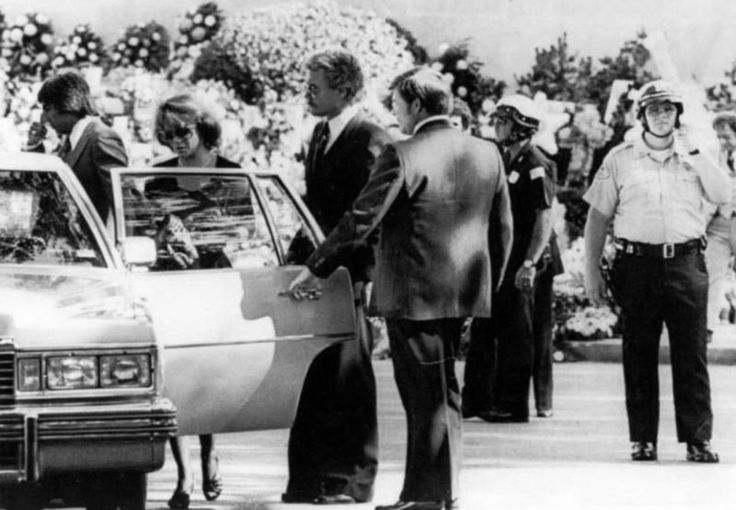 Ann Margret with her husband Roger Smith (mustache next to the man holding the car door)  at Elvis funeral - getting into one of the 17 white limos that drove down Elvis Presley Blvd from Graceland where the service was held to Forrest Hills Cemetery.