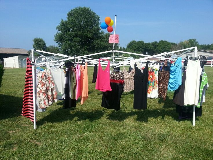 Yard sale ideas!  Had a canopy that the top was ripped and made it into a clothes rack for a yard sale!  Worked perfect for clothes people loved it!