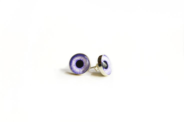 What's the best way to bring out the color in your eyes? By wearing sterling silver taxidermy eye earring studs of course!  Rogue taxidermy is the creation of stuffed animals which do not have real, live counterparts; They may represent mythical creatures such as dragons, griffins, unicorns or ...