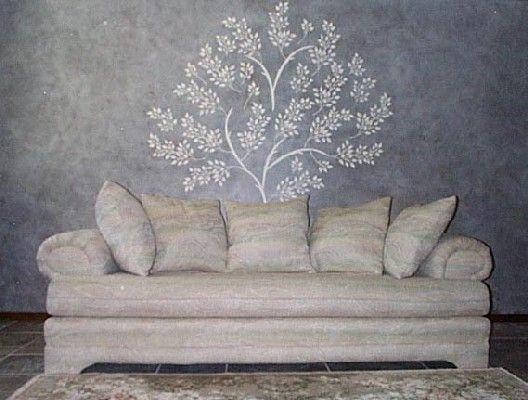 Immaginare che, un singolo, generato albero di intonaco sulla tua bacheca, foglie e rami letteralmente schioccando da parete, illuminazione