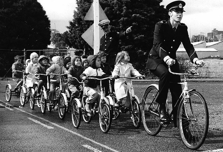 From 1964, the SA Police Road Safety School educated more than 500000 children between ages 4 and 13 about the road rules and safe road use. The safe environment contained a miniature dual lane roadway, railway and school crossings and pedestrian operated traffic lights which assisted many children. Children pictured are being led by Cadet Martin Dillon.    Picture reproduced courtesy of the South Australia Police Historical Society.  #history #safety #education #police #bicycles…