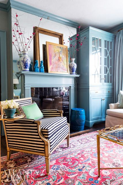 Mix of mirror, trim work, layered artwork and colors.