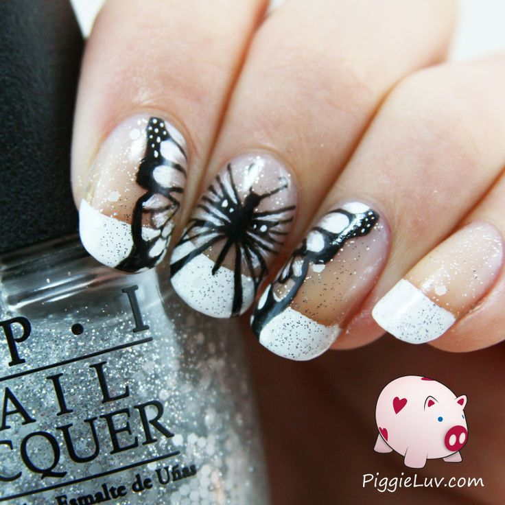 I hand painted this black and white butterfly a few days ago, isn't it beautiful? I painted this nail art design with black and white acrylic paint, and my super awesome Christrio detail brush, op top of a base of OPI Pirouette My Whistle.