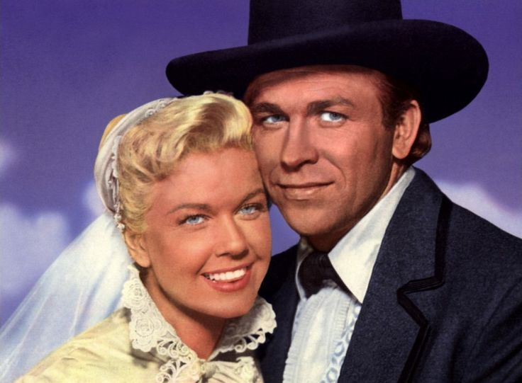 """Doris Day, Howard Keel, """"Calamity Jane"""" one of my favorite movies ever! not only was he tall dark and handsome, his voice would melt butter!"""