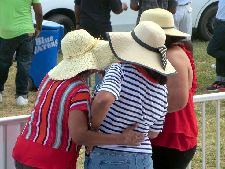 Three Trinidadian ladies enjoying some afternoon pan drumming in Queen's Park Savannah, Port of Spain.