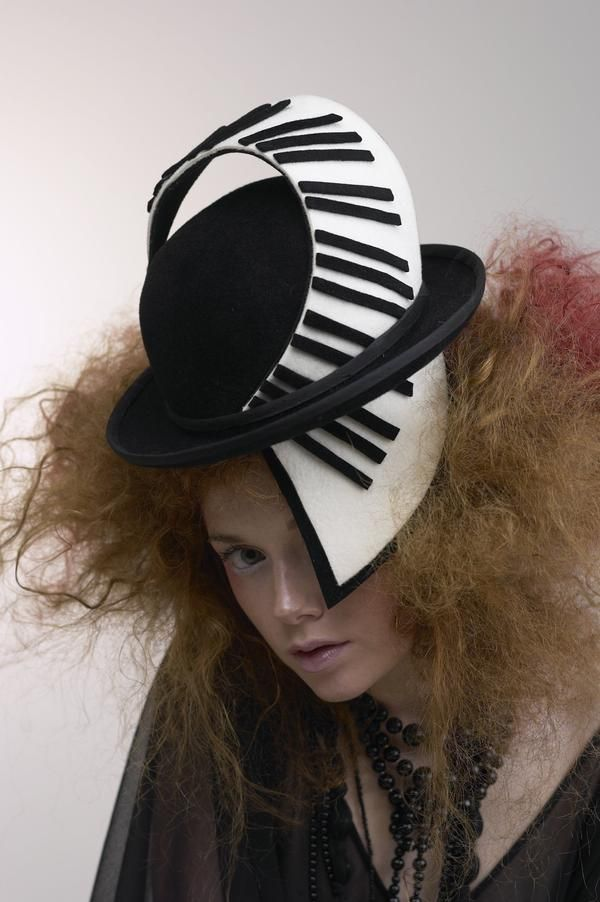 Elizabeth Parker.  I don't like the hat per se, but the intersecting brim/sweep strikes my fancy.