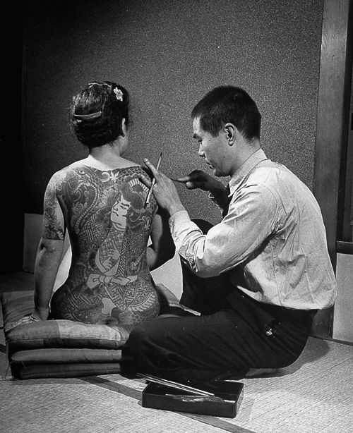 Female Yakuza getting inked.