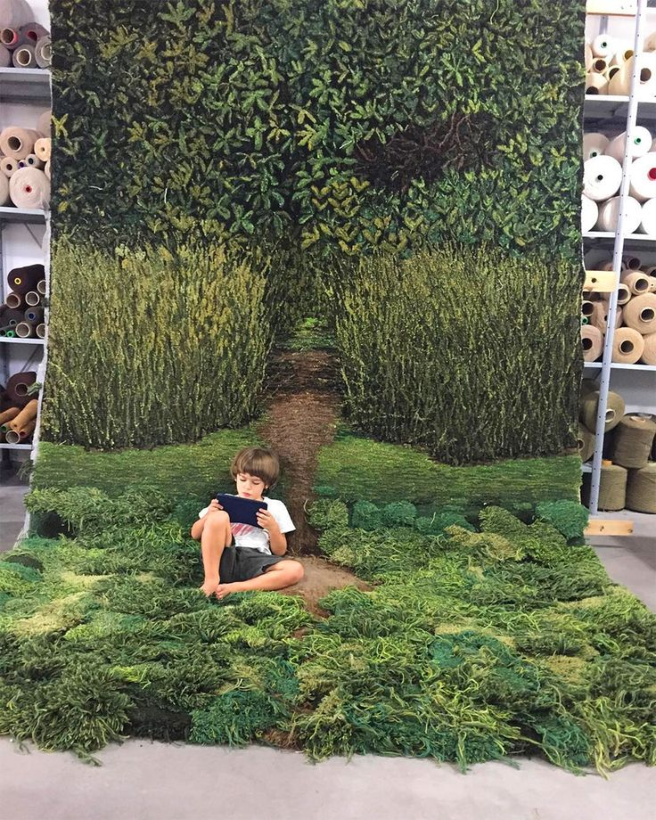 Using scraps leftover thread from her family's carpet factory in Buenos Aires, artist Alexandra Kehayoglou embarks on a laborious hand-tufting process to create wool carpets and rugs that mimic natural textures like moss, water, trees, and pastures.