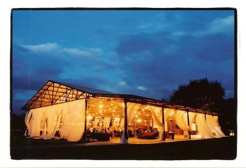 barn farm wedding with curtains and string lights