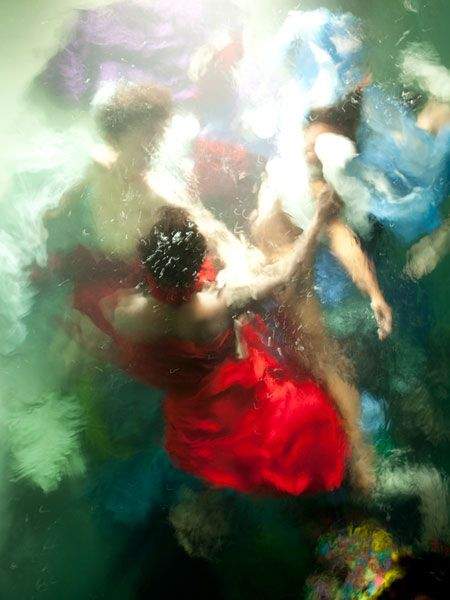 Hawaii-based photographer Christy Lee Rogers specializes in creating dreamlike photos of people underwater. Her project Reckless Unbound shows people swirling around one another while wearing colorful outfits.