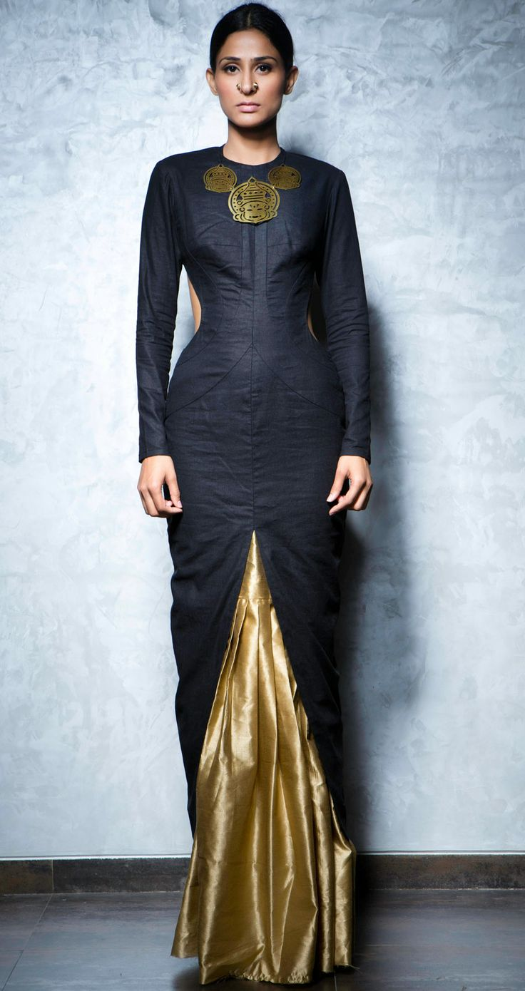 Back cut out black linen kurta with a front slit along with a gold silk skirt by NIKHIL THAMPI http://www.perniaspopupshop.com/lakme-fashion-week/nikhil-thampi/nikhil-thampi-black-kurta-with-gold-skirt-nktlfw081311.html