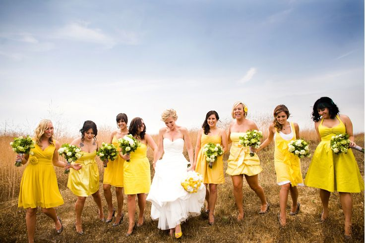 Yellow mix-and-match bridesmaids' dresses give your bridal party a big pop of color.
