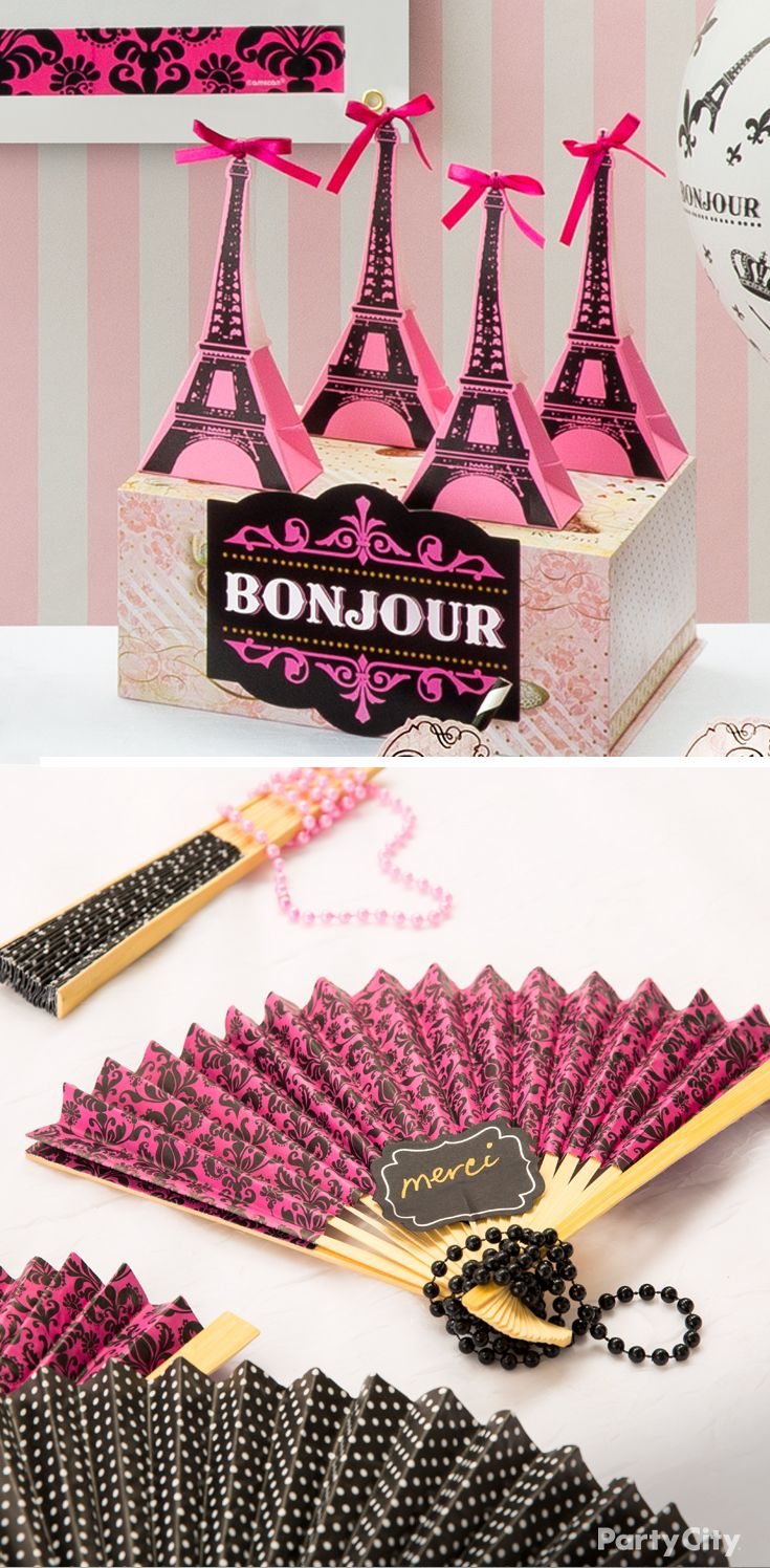 "Hunting for favor ideas for your Paris-themed party? Offer A Day In Paris Eiffel Tower boxes full of sweets, or festive beads and fans as way to say ""merci for coming!"""