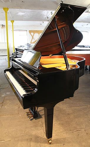 A Yamaha GA1 baby grand piano for sale with a black case and tapered, square legs at Besbrode Pianos. Piano has three pedals and eighty-eight notes.