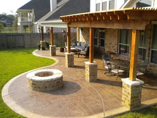 """This """"continuation"""" of the back patio with the addition of the pergola is kind of what I want in our back yard. I don't want the curved area where that fire pit is though. A fire pit will be separate and in its own spot..."""
